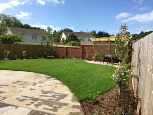Garden with seating area, trellis, house patio and lawn