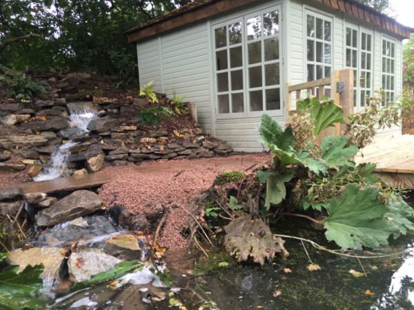 Water feature running alongside boat house
