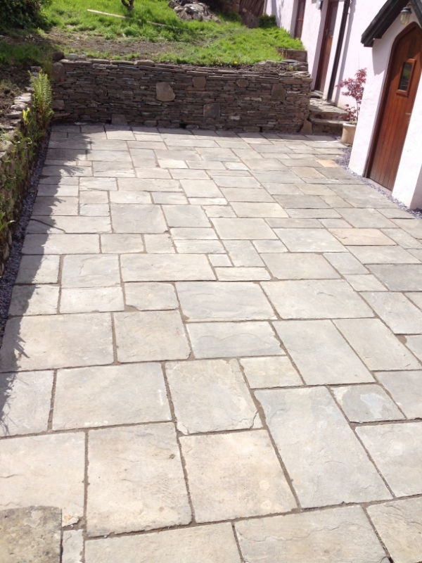 Kennel stone patio with raised wall