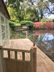 Pond house decking with gate