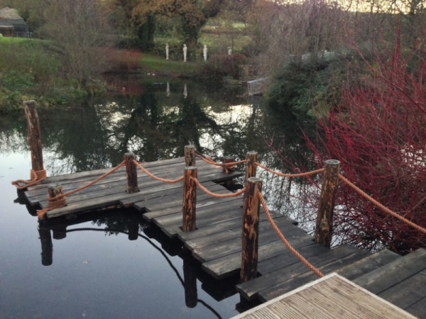 Pontoon boat stand in water